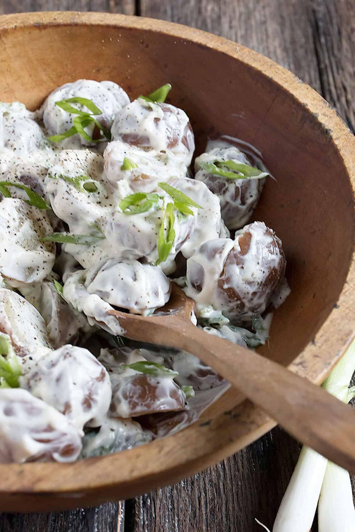 sour cream potato salad in wooden bowl