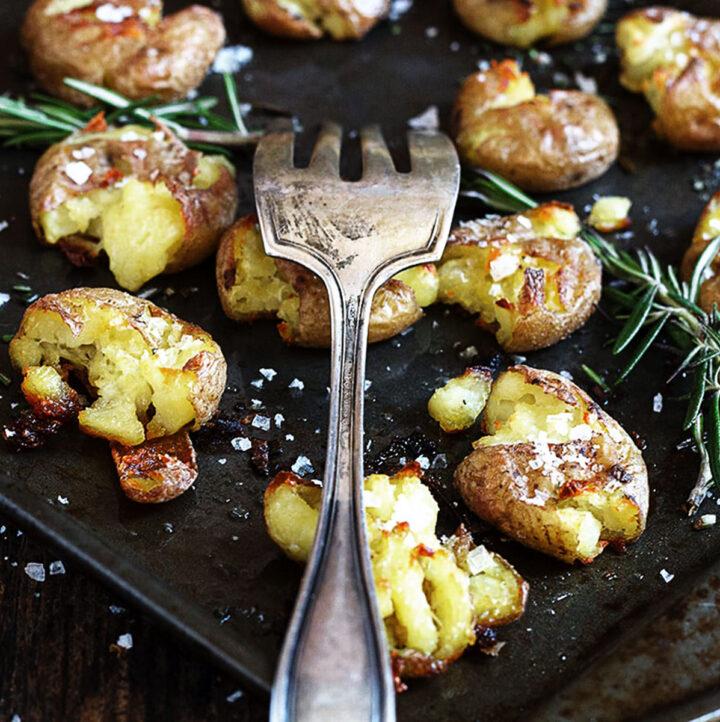 rosemary smashed potatoes on baking sheet