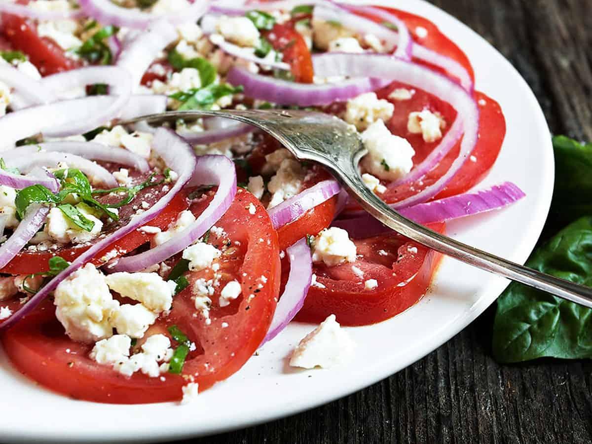 tomato feta salad on white plate