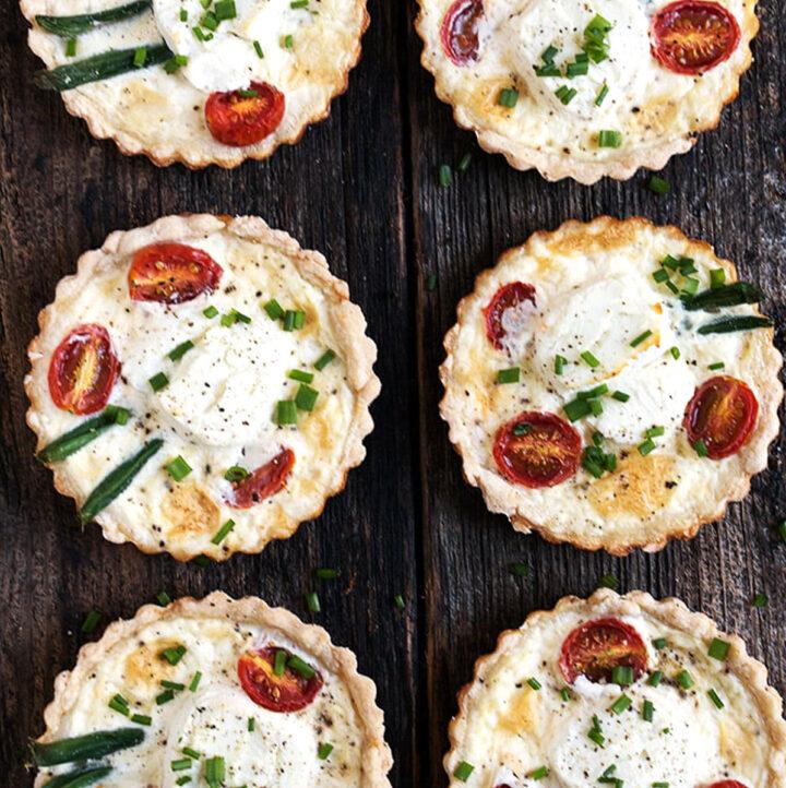 goat cheese tomato tarts on wood background