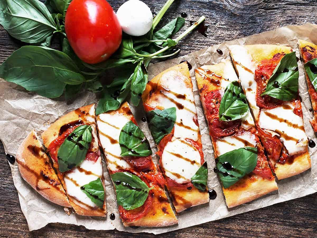 tomato bocconcini flatbread on wood background