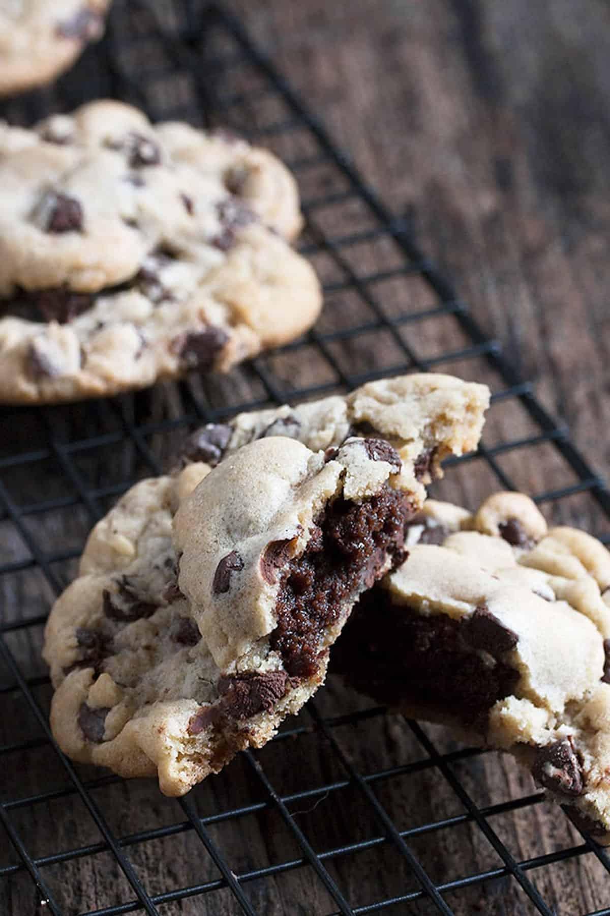 brownie stuffed chocolate chip cookies on cooling rack