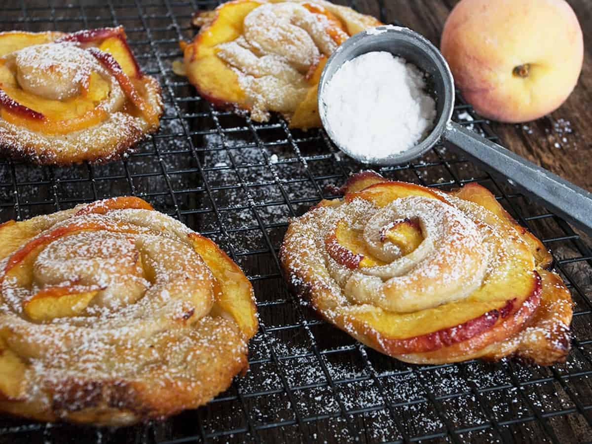 rose-shaped peach puff pastries on cooling rack