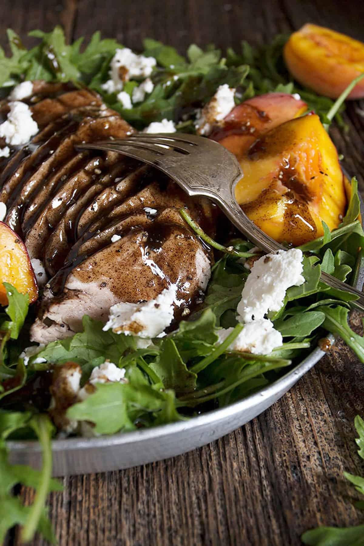 balsamic pork tenderloin and peach salad on platter