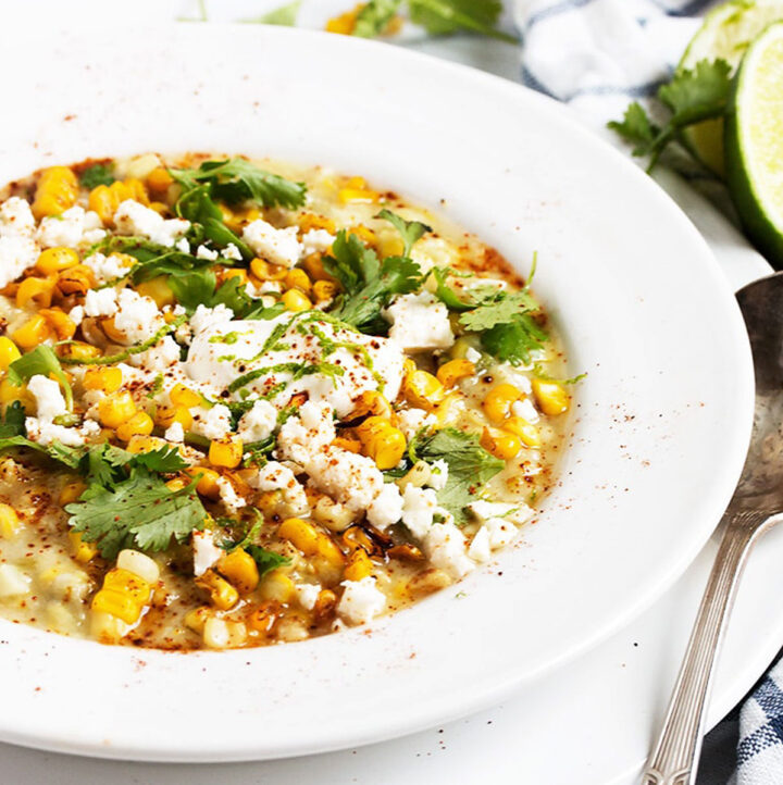 Mexican street corn soup in white bowl