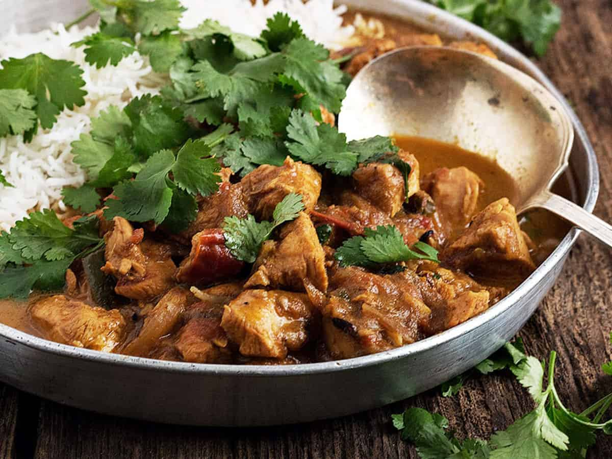 chicken coconut curry on platter with rice