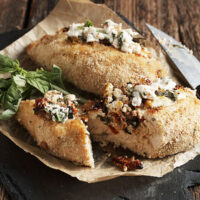 goat cheese stuffed breaded chicken on parchment