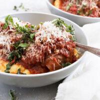 pork prosciutto meatballs in bowl with polenta