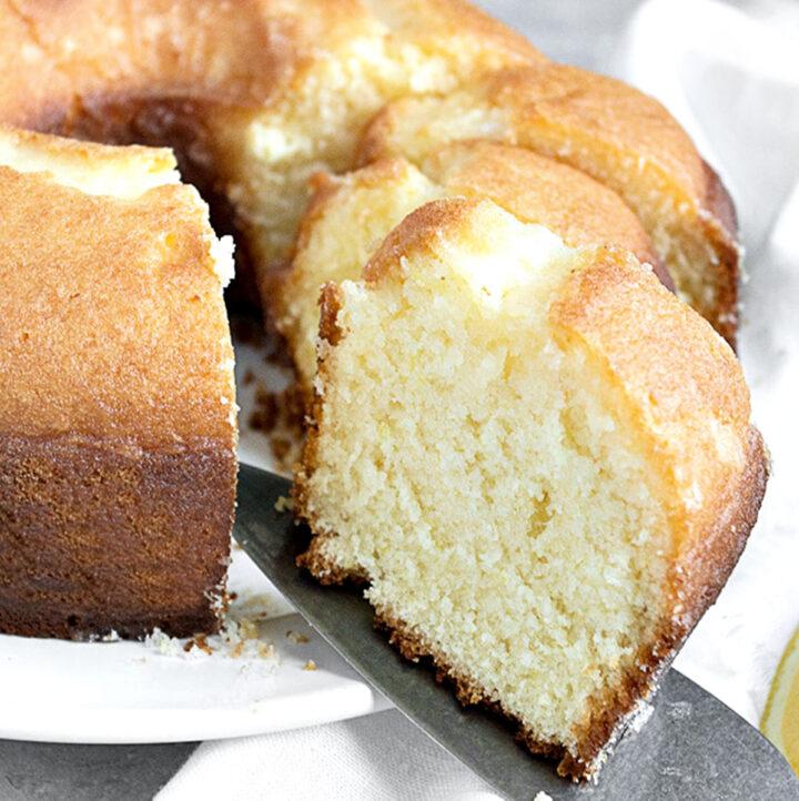 lemon tube cake sliced on white plate