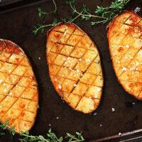 roasted russet potatoes with malt vinegar on baking sheet