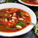 tomato bean soup with spinach in bowls
