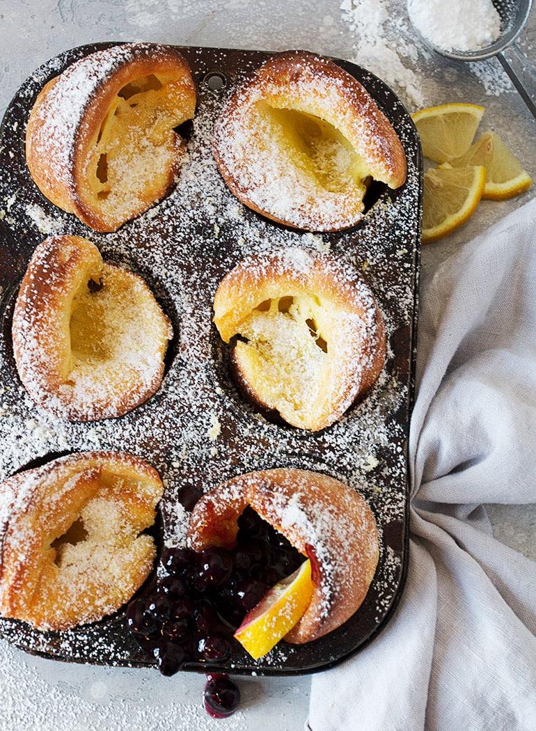 Mini Lemon Sugar Dutch Baby Pancakes with Blueberry Sauce