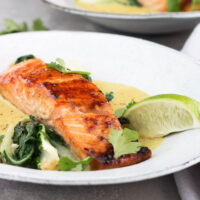 sugar-seared salmon in bowl with coconut lime sauce