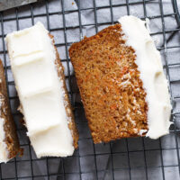 carrot cake loaf with cream cheese frosting sliced