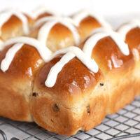 hot cross buns on cooling rack