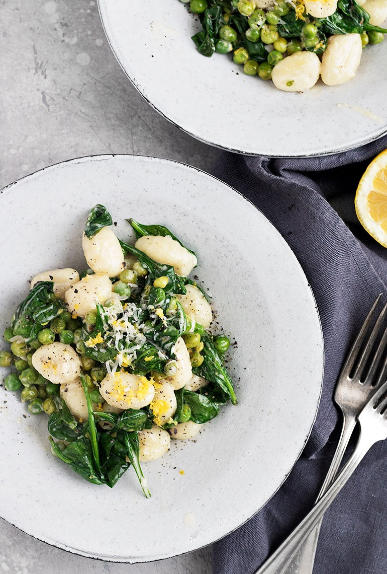gnocchi with peas and spinach with lemon, in a bowl