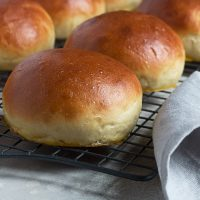 homemade burger buns on a cooling rack