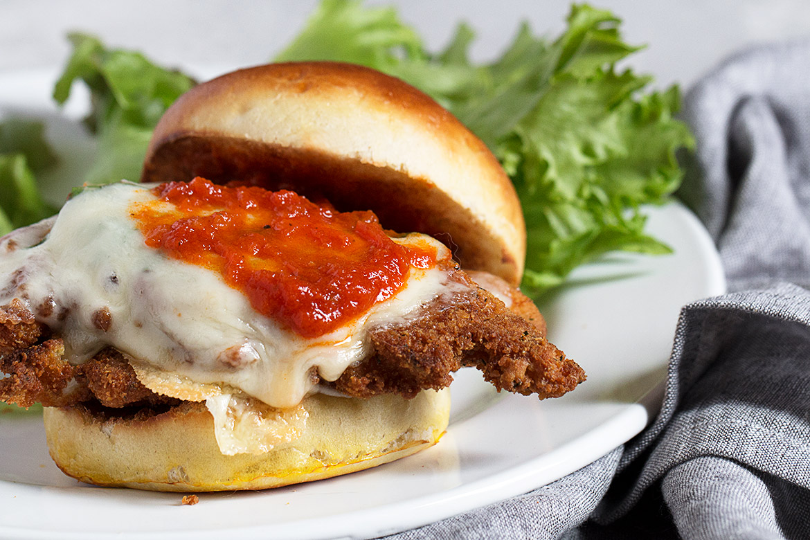 chicken parm on a bun on a plate