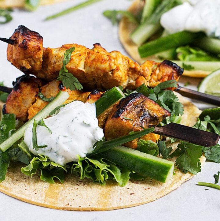 chicken tikka tacos on board