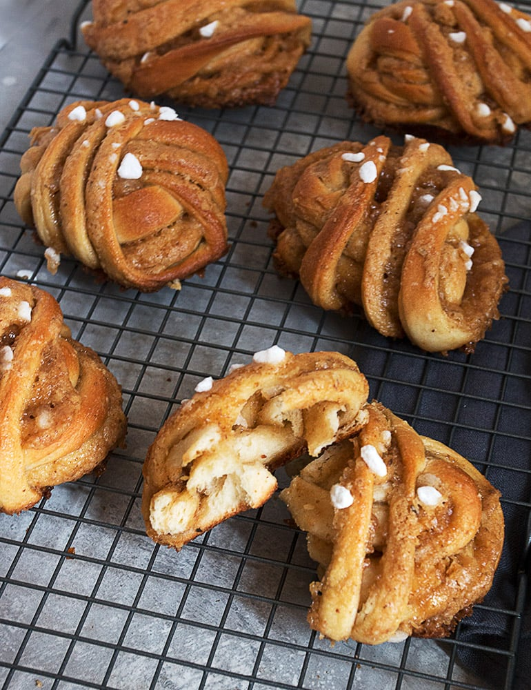 maple walnut rolls on cooling rack with one broken in half