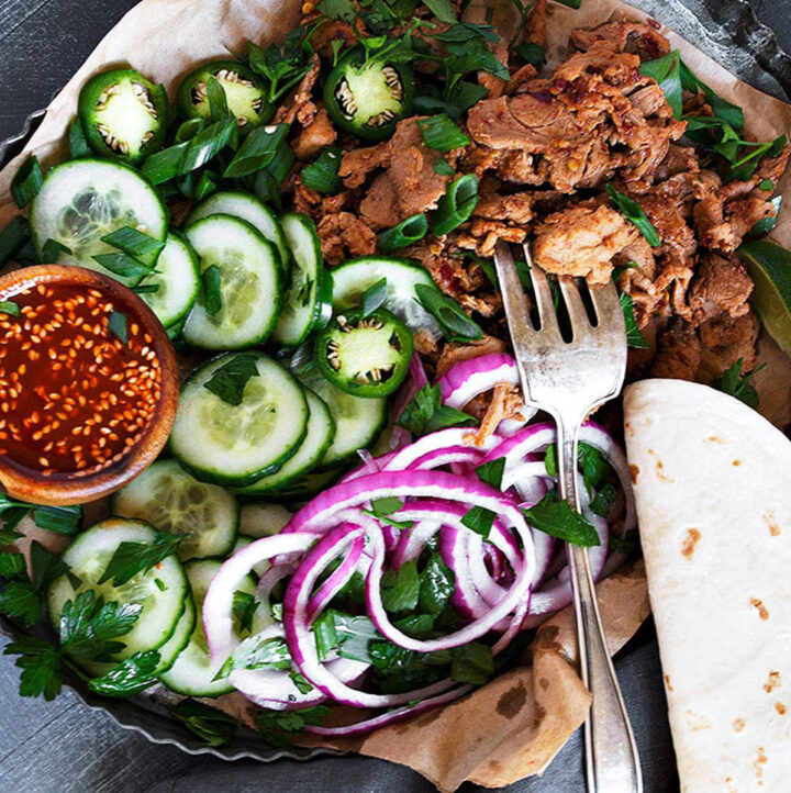spicy pork tacos on platter