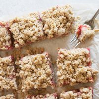 strawberry rhubarb crumble squares overhead on parchment