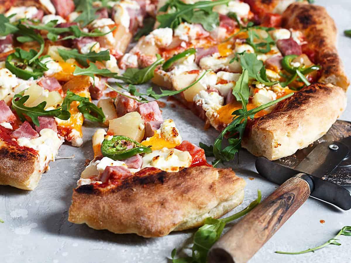 three cheese Hawaiian pizza sliced