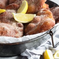 beavertails on platter with lemon slices