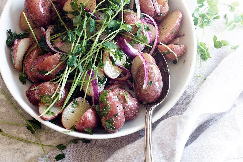 mini red potato salad in white bowl