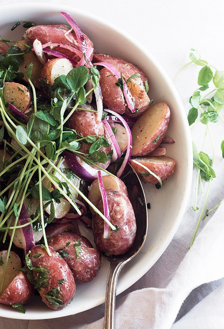 mini red potato salad in white bowl