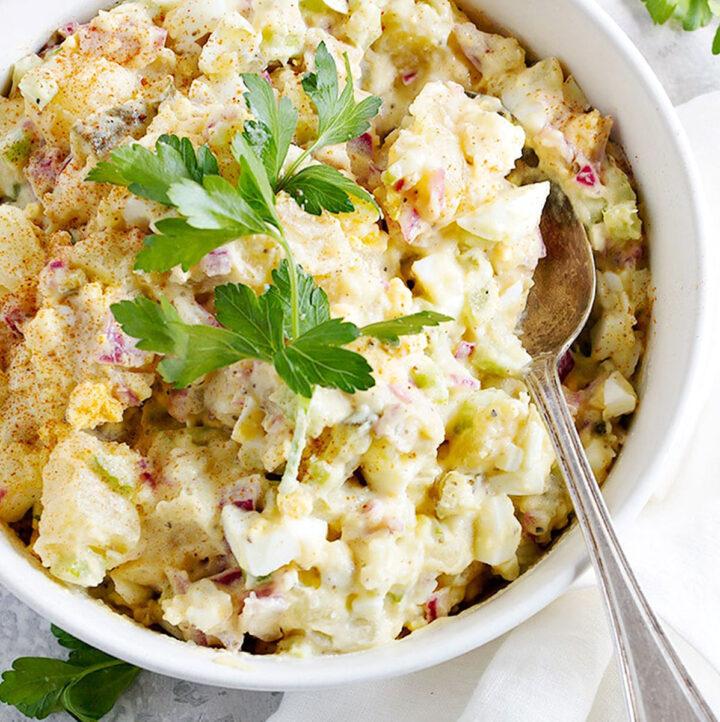 classic potato salad in white bowl