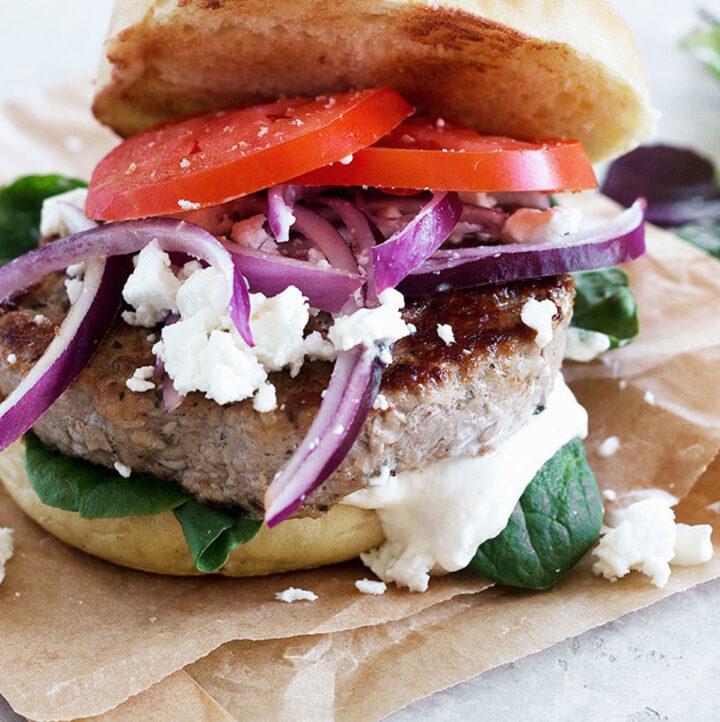 pork souvlaki burger on parchment