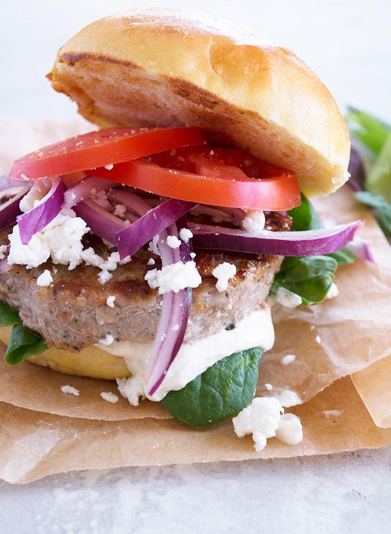 pork souvlaki burger on paper