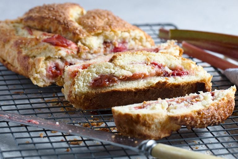 rhubarb biscuit jelly roll, sliced on cooling rack
