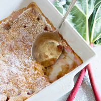 rhubarb pudding cake in pan with spoon