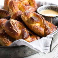 soft pretzels on tray with a cup of beer cheese