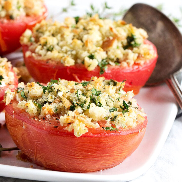 baked tomatoes with crumb topping on plate
