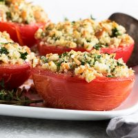 baked tomatoes on white plate