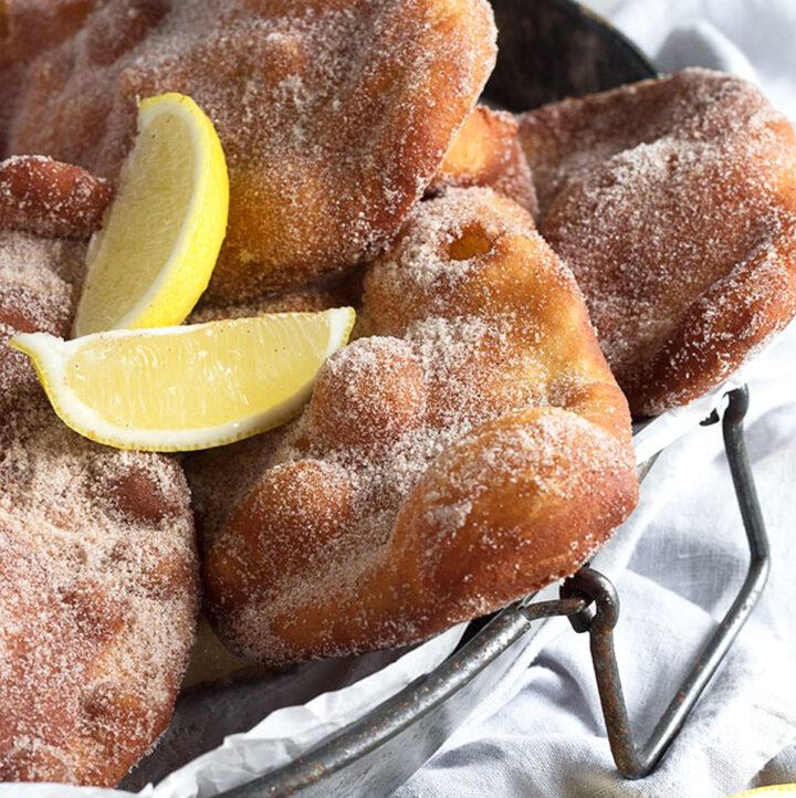 beavertails on platter with lemon wedges