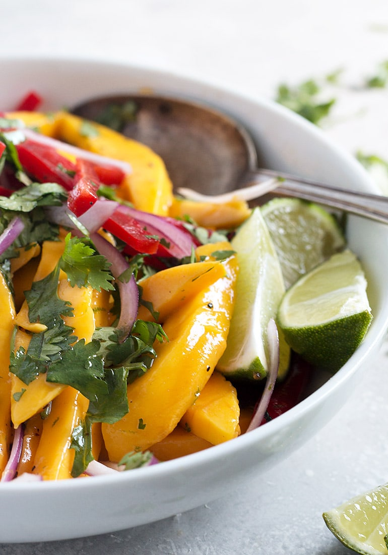 mango salad in white bowl