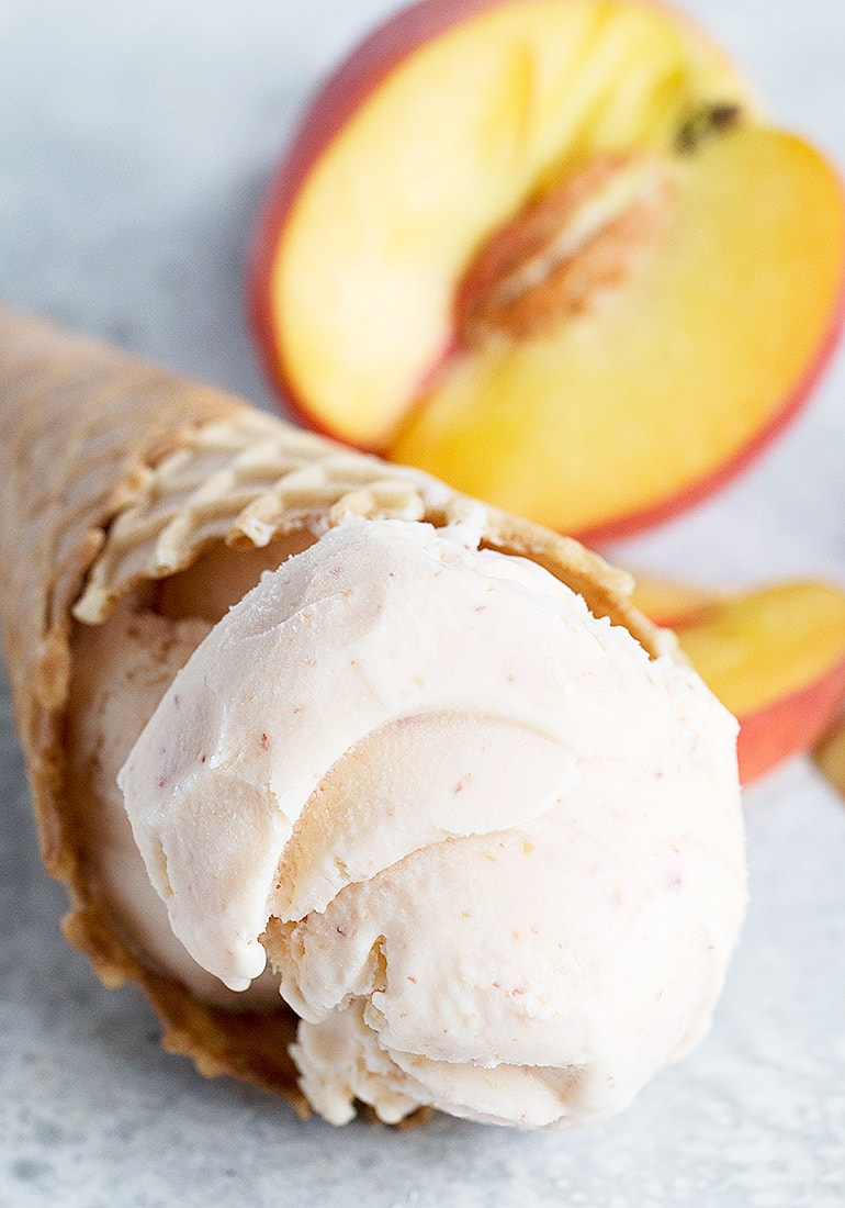 fresh peach ice cream in cone