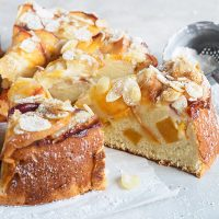 peach ricotta cake, sliced