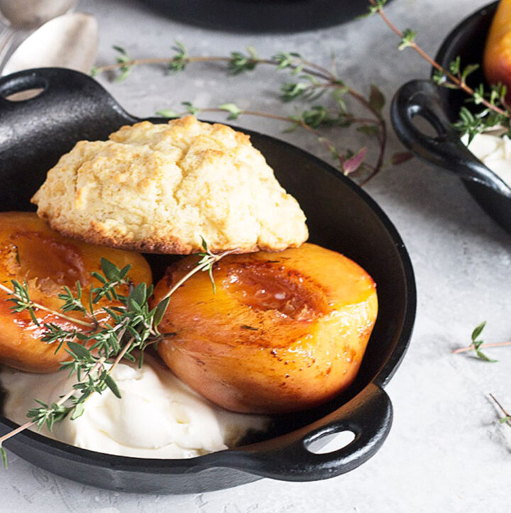 grilled peaches with biscuits in skillets