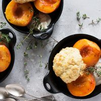 glazed peaches and biscuits in cast iron skillet