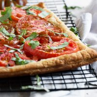 tomato ricotta tart on cooling rack