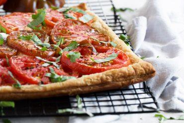 tomato ricotta tart on cooling rack