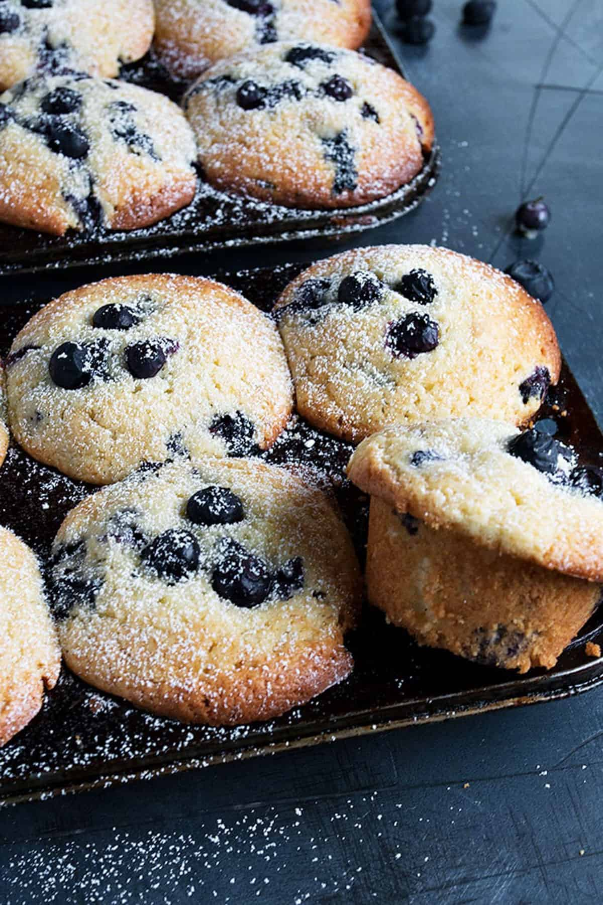 blueberry lemon muffins in muffin tins