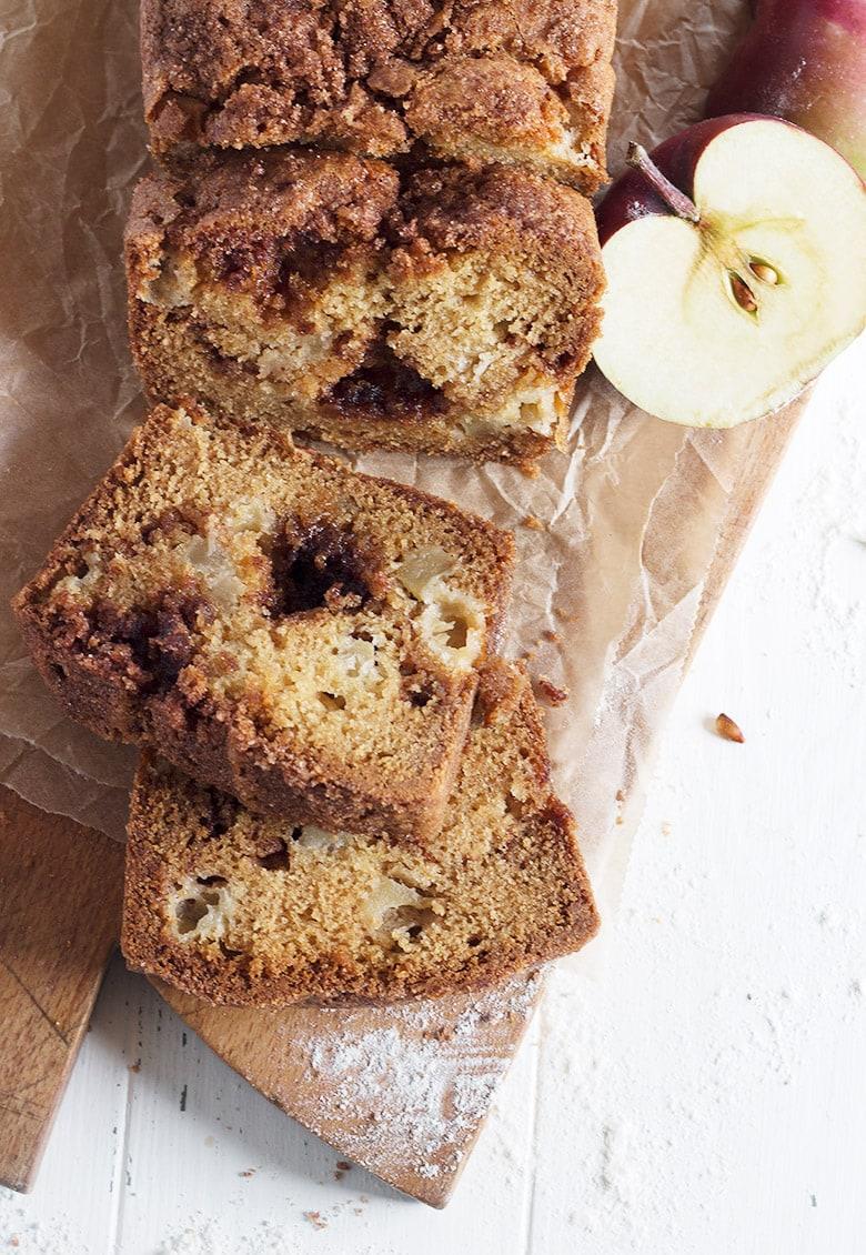 cinnamon apple bread sliced on cutting board