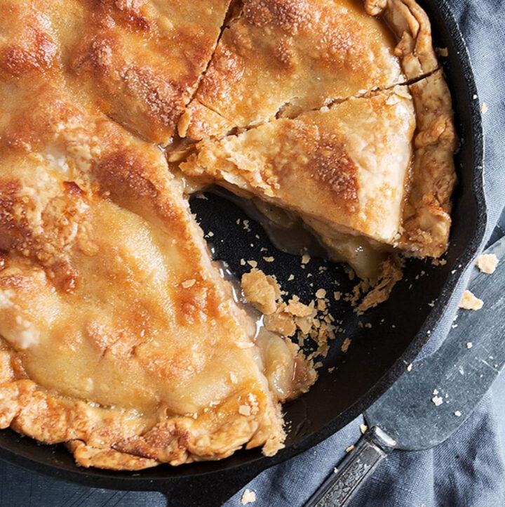 brown sugar peach pie sliced in cast iron skillet