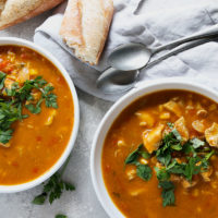 pumpkin chicken and rice soup in white bowls